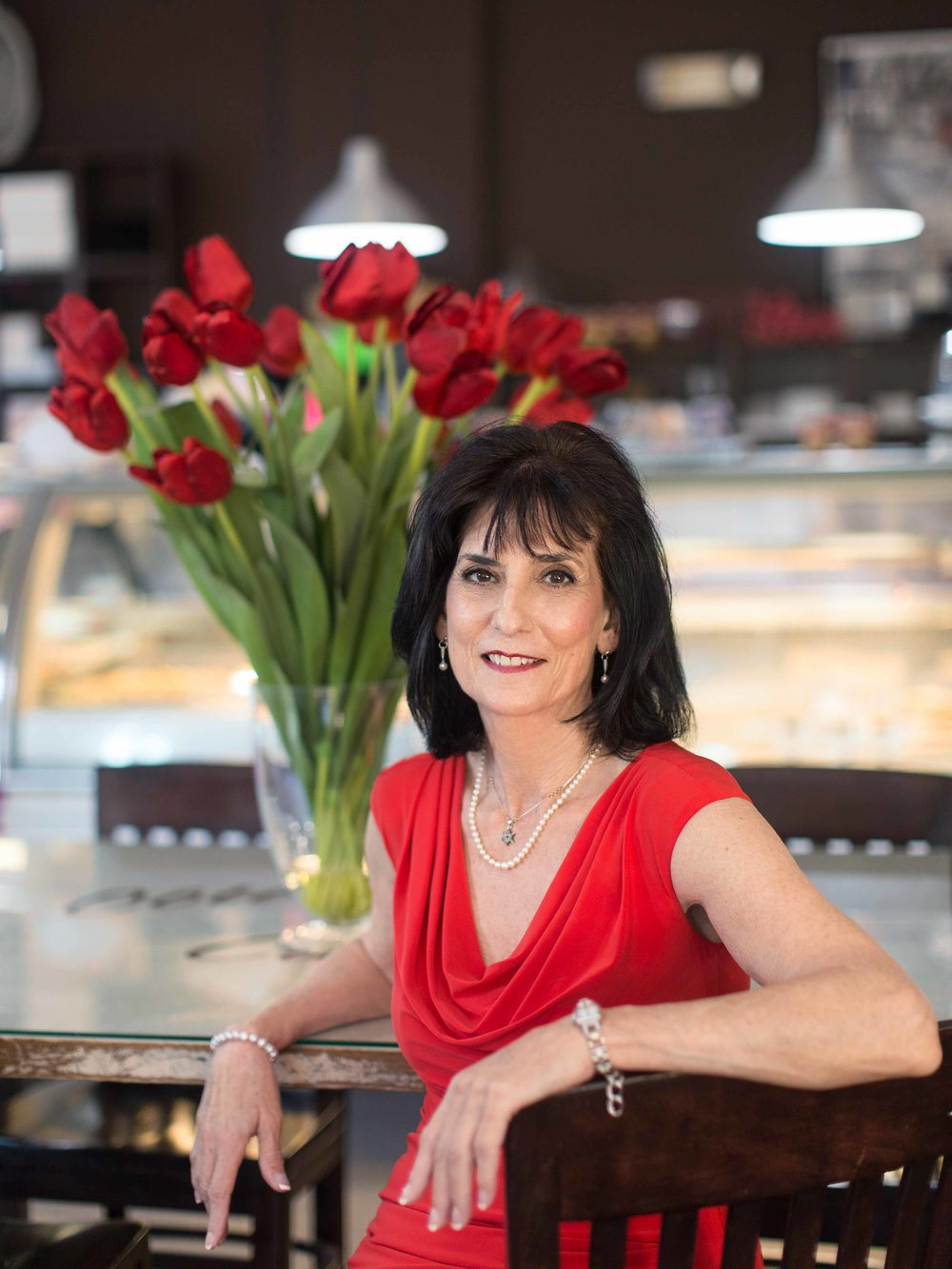 personal-branding-photography-realtor-red-dress-red-tulips-french-cafe-boca-raton-south-florida