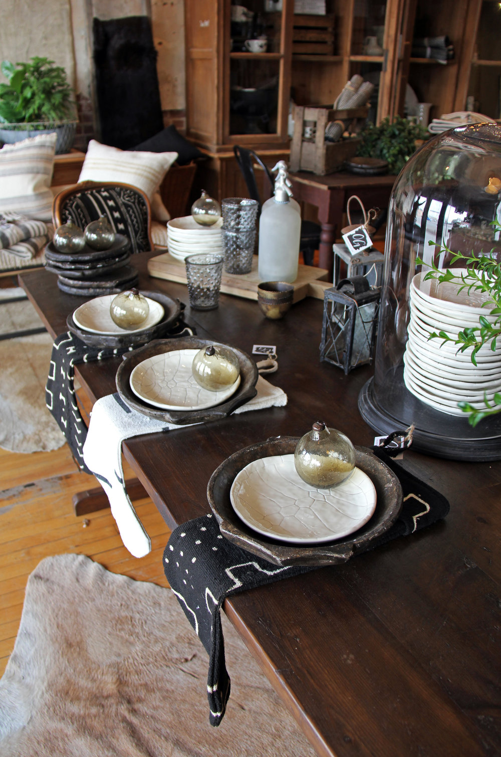 Tortoise shell plates for a festive and fun table setting, complete with chargers, hobnail glasses, antique European lanterns, and old frosted seltzer bottles!