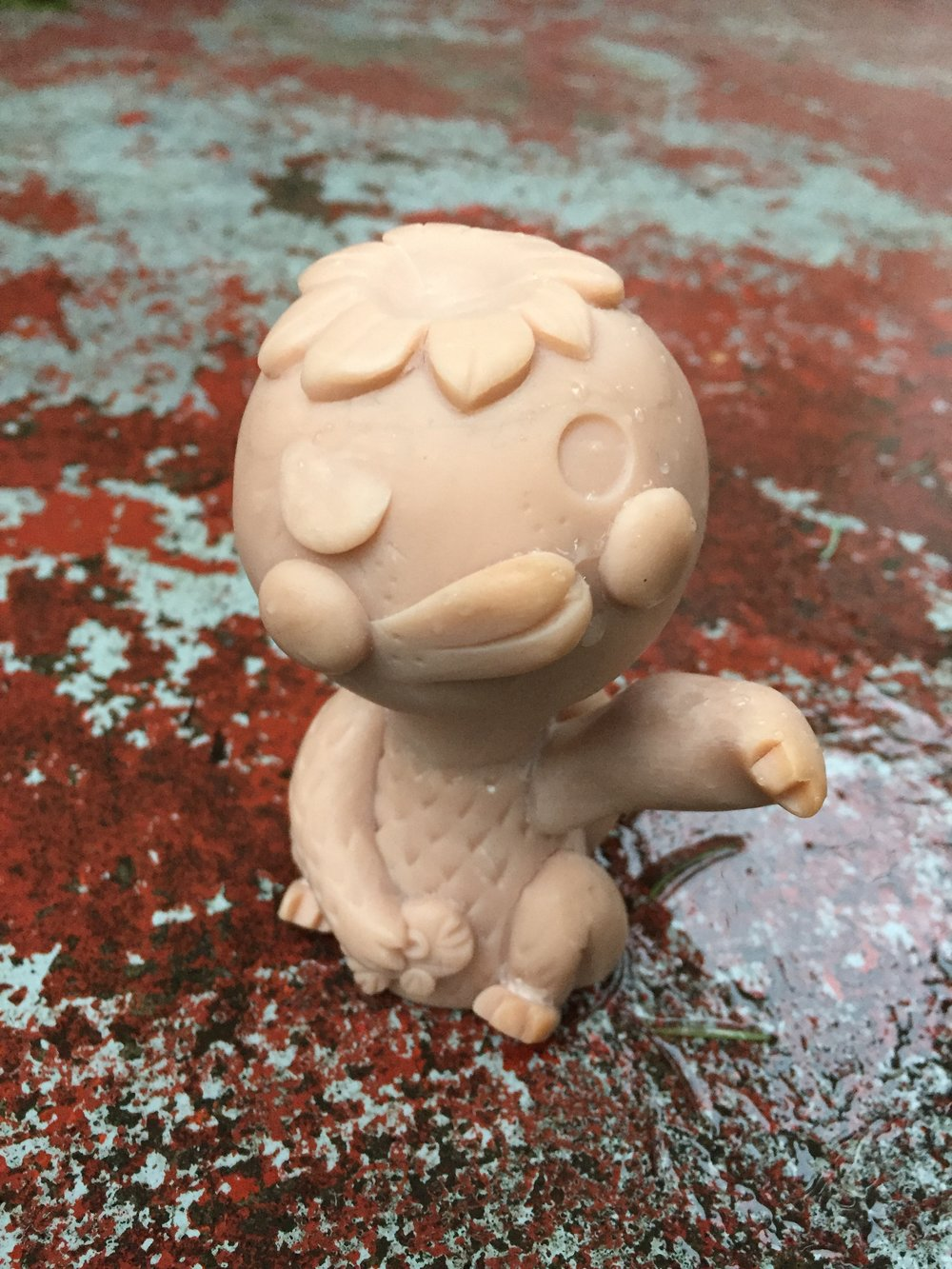 Here's a shot of the sculpt. She is buried in silicone right now. I'll do one version for Skulls club, and a second public version as well.  Place Kiwi by your front door and rub her shell for good luck on your way out, put here in your restaurant for good health, or your shop as an anti-theft charm.  This first kiwi is resin. Although there is a chance she could make it to sofubi. I wouldn't count on that. I am so backed up with sofubi projetcs still from last year, by the time it happens I probably will have sculpted some new treasure to be made into soft vinyl:)
