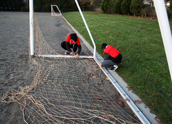 Omar and Fernando diligently fixing one of the soccer nets.