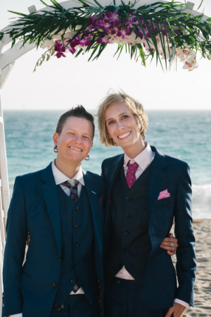 Barb (left) with her wife Jesse at their Malibu wedding in Kipper Suits.