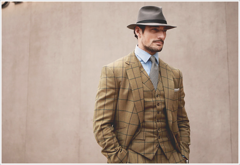 David Gandy // Focus: His window-pane suit with a rich, desert brown background.