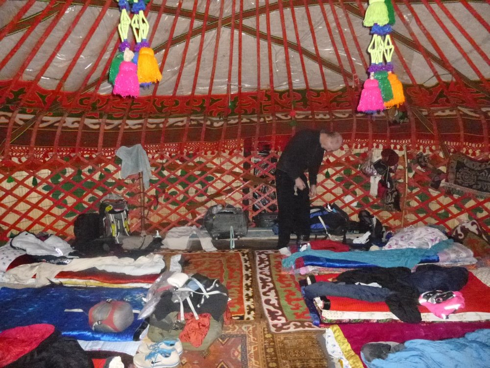 Each yurt has a colourful interior with elaborate carpets, foam mattresses, and embroidered blankets.