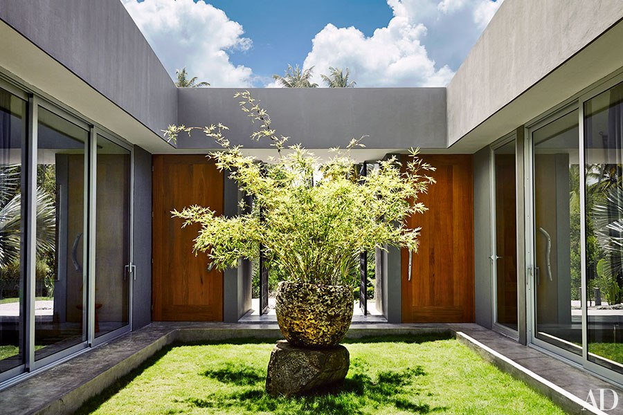 Central courtyards opens to interiors to create one large outdoor room.