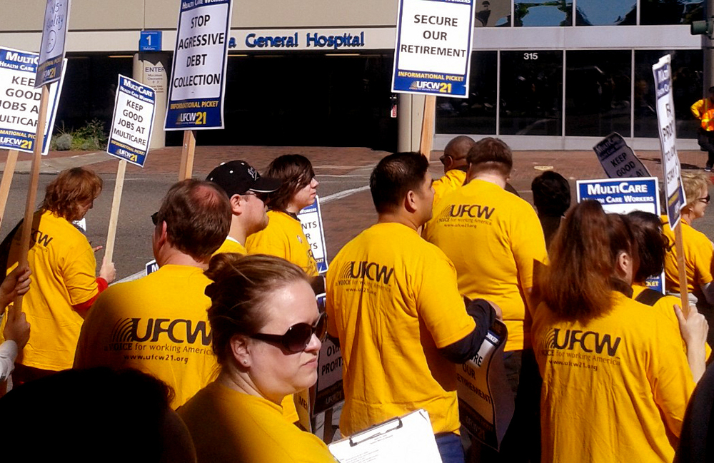 MultiCare members take part in an informational picket outside of of tacoma general hospital on thursday april 16, 2015.