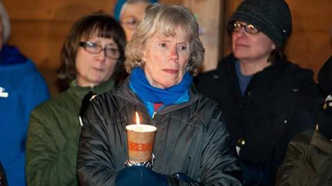 Sue Wilmot (Checker, Safeway Bainbridge Island) joined by a MaryAnn Schroeder (Meat Wrapper, Safeway Seattle) right and left of the speaker, take part in a candlelight vigil opposing the growing anti-Muslim rhetoric in our society. Sue and others came together around the memorial site of the Japanese expulsion from Bainbridge as a way to raise awareness of a past time when fear led to hundreds of thousands of people with Japanese ancestry being rounded up and put on trains and jailed. That was not our finest hour as a nation and we today have the responsibility to resist reliving these dangerous decisions.