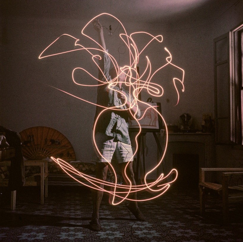 """historicaltimes :     Pablo Picasso """"paints"""" with light, photographed for Life Magazine by Gjon Mili,  1949 ."""