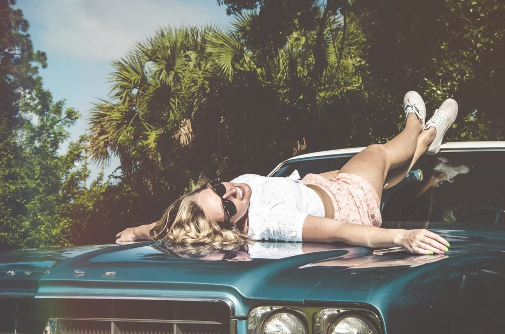 """unsplash :       'I really enjoy vintage lifestyle, so I try to take pictures of vintage/retro objects as often as I can. A couple summers ago one of my friends brought his muscle car down to Florida and let me borrow it for a day. So I did some trials on """"pin up girl"""" shooting with another friend (this was also my first photoshoot with human in it too lol).'   Photo and words from Aral Tasher , Florida.   unsplash.com/araltasher"""