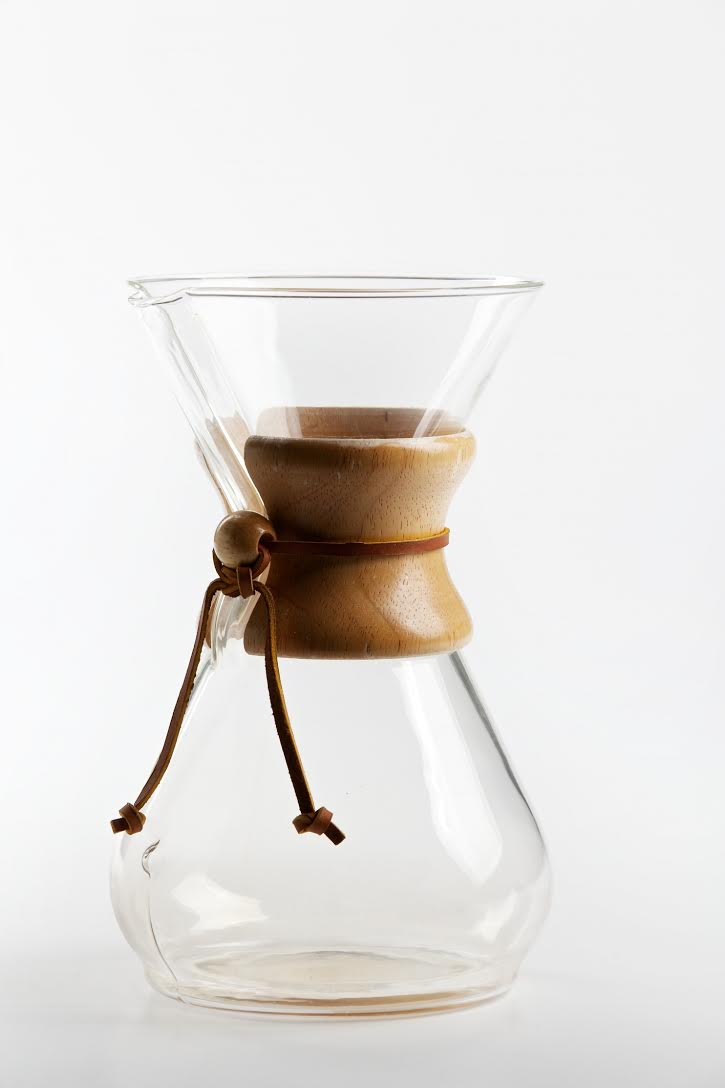 Chemex - Eight Cup Maker The beautiful hourglass design of the Chemex uses a bond filter heavier than most, which filters out oils and sediment to make a smooth, bitter free coffee. It can also produce 8 cups at a time for more coffee enjoyment.  Cons include the Chemex Brand filter that is needed to use it and  a specific long handled brush to clean up properly. In addition, the Chemex often does not produce the complexities in the coffee found in the other brewing devices.