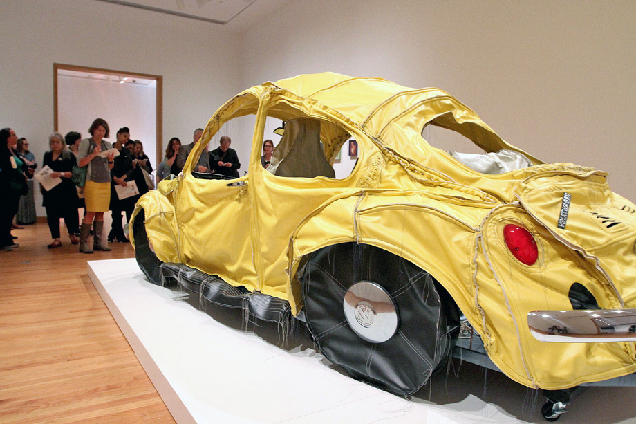"Mexican artist Margarita Cabrera's ""Vocho (yellow),"" a mixed media piece of hand-stitched vinyl, batting, thread and car parts depicting a VW Bug."