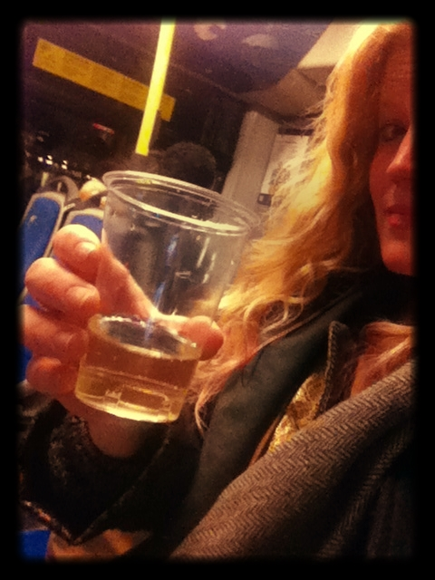 Lindsay_drinking_wine_on_a_bus