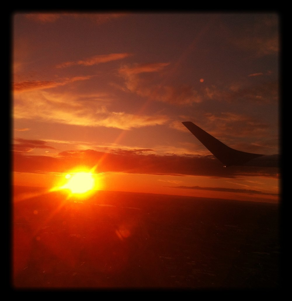 View_through_the_window_of_a_plane_during_sunset