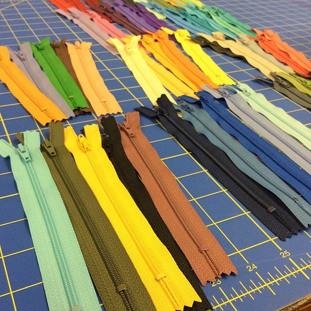 The next stage is coordinating the zippers, which I get from the lovely ladies at Sew Dayton, and fabric for the inner lining. As a thrift store junky, I am able to find lots of amazing fabrics that I bring home, wash and upcycle into their new form.