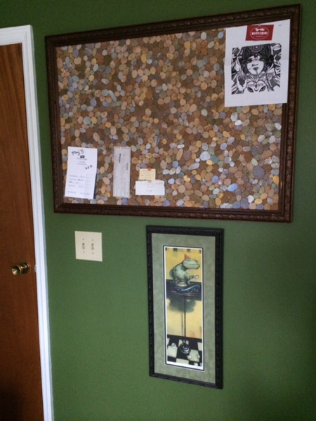 I was determined to get organized with this remodeling. This is the board near the entrance to the studio. This is where I post projects in progress or timely items that I need to keep in mind, such as show deadlines or pick up dates. I made this with an old frame, some sheets of cork and then I glued some of the hand cut cork pebbles from my UD show to give it some flair.