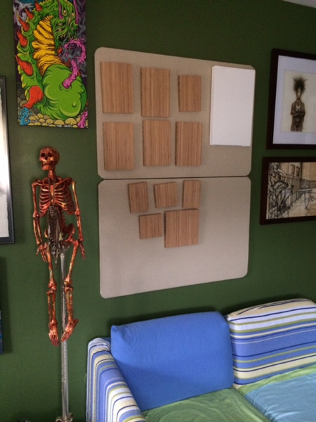 These cork boards over the sofa are were I will post work in progress. Right now they are home to the bamboo panels I purchased from the Portland, Oregon based company, Plywerk. Soon they will be paintings! You can also see that my skeleton, Roger, is right at home in the new space below the work by Scarecrowoven! I have moved a good amount of our acquired art collection to the studio so I can be inspired by my fellow artists as I create new works in my new amazing space!