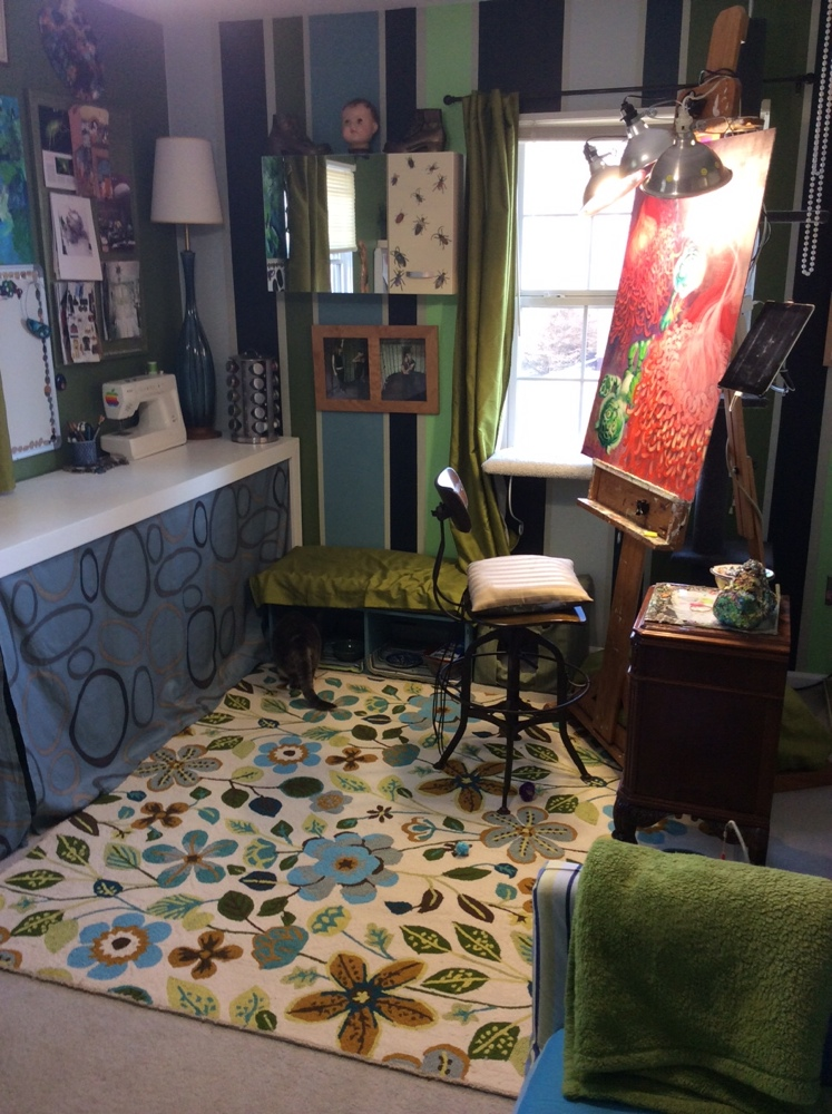 After countless hours and several trips to Decoy Art Studio, the studio is finished! The rug was my major splurge item. I must have looked at hundreds of rugs at all sizes and prices, but that one was PERFECT! The one thing I did not take into consideration was the fact that it is looped wool, which our kitten, Boo, says makes for a lovely scratching surface. Sigh…
