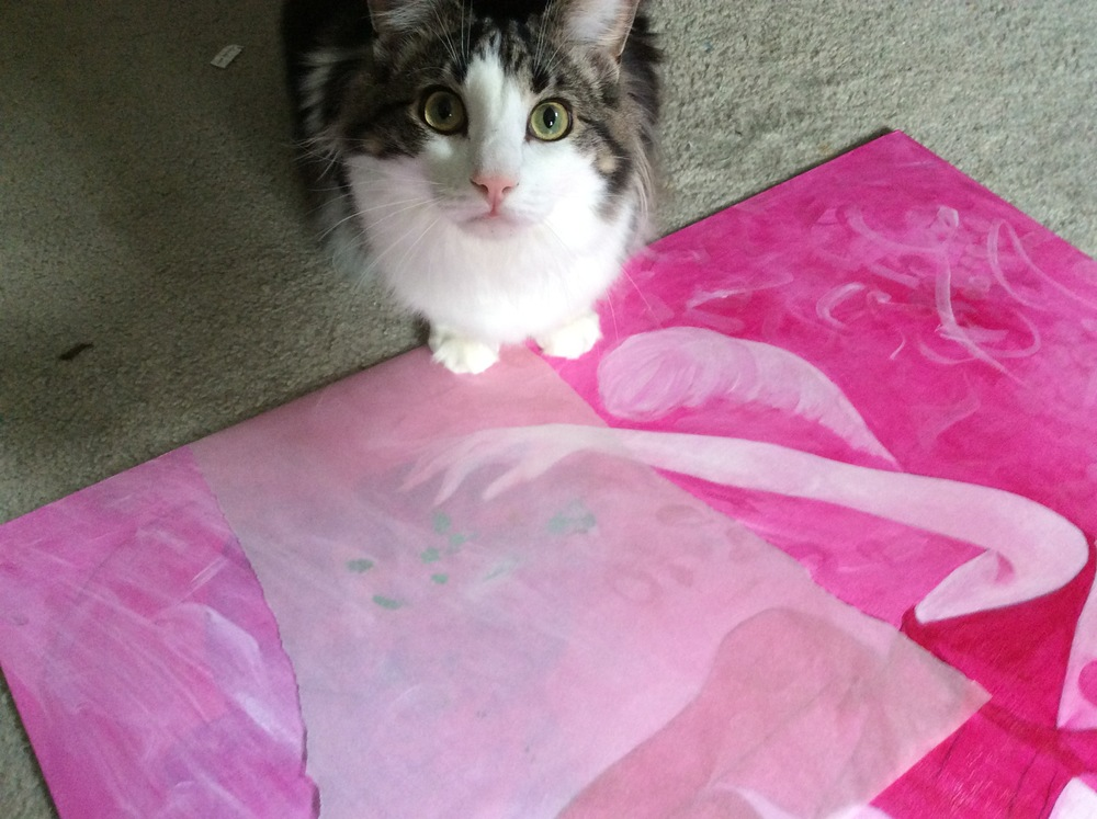 Boo assists with the tracing paper for a second cat.