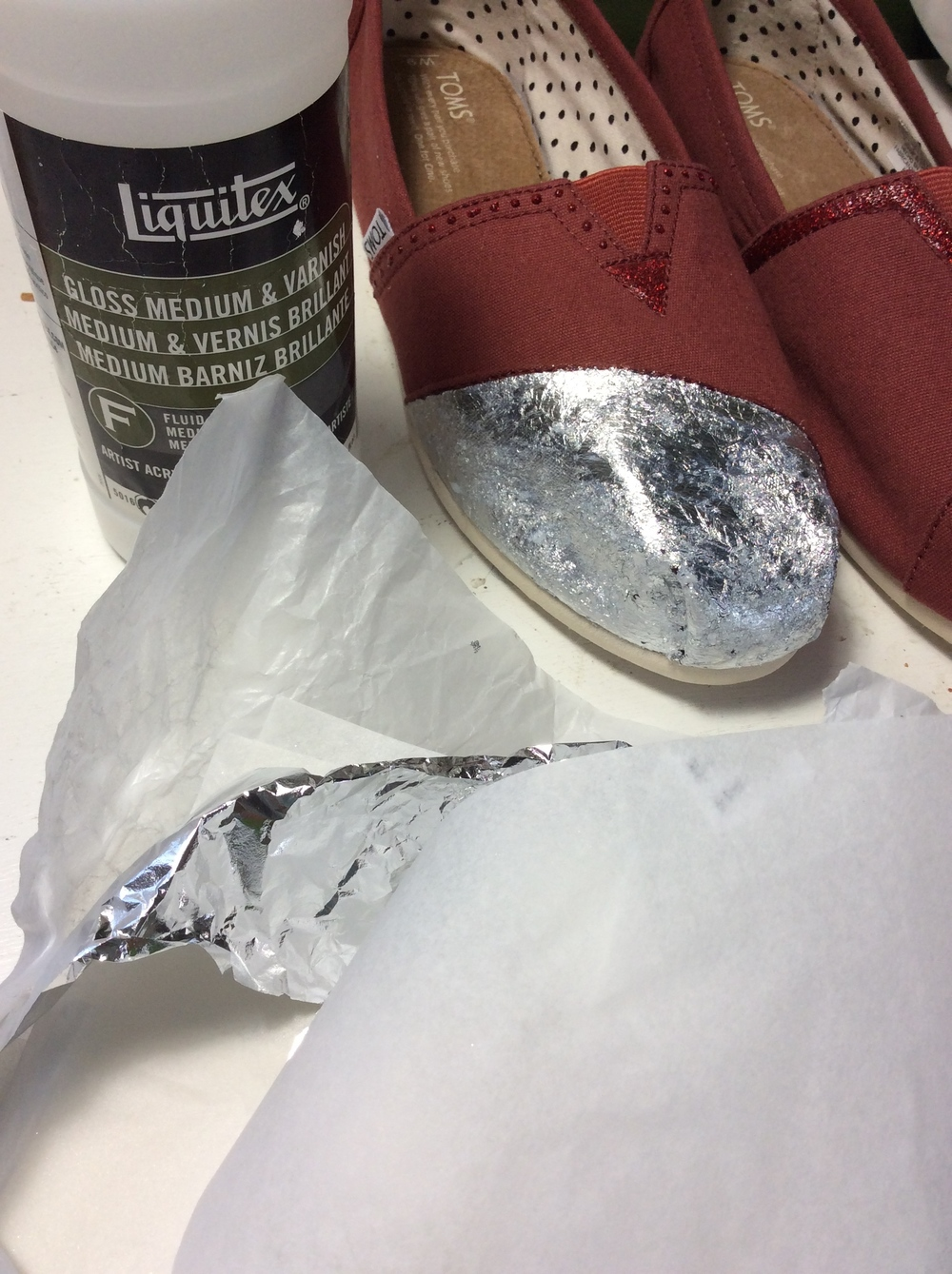 Adding a silver foil base to one of the toes.