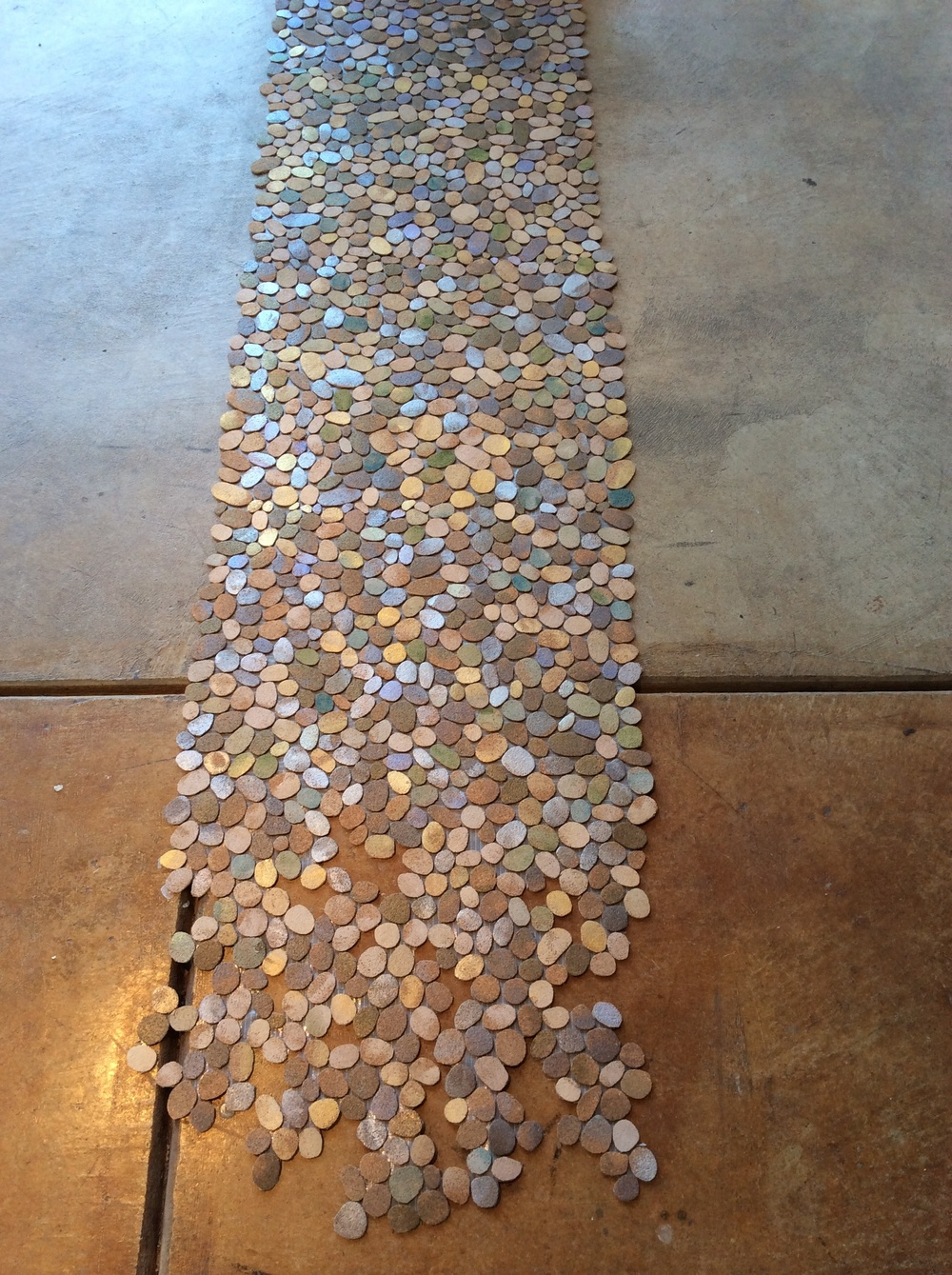 Installation view of cut cork pebbles