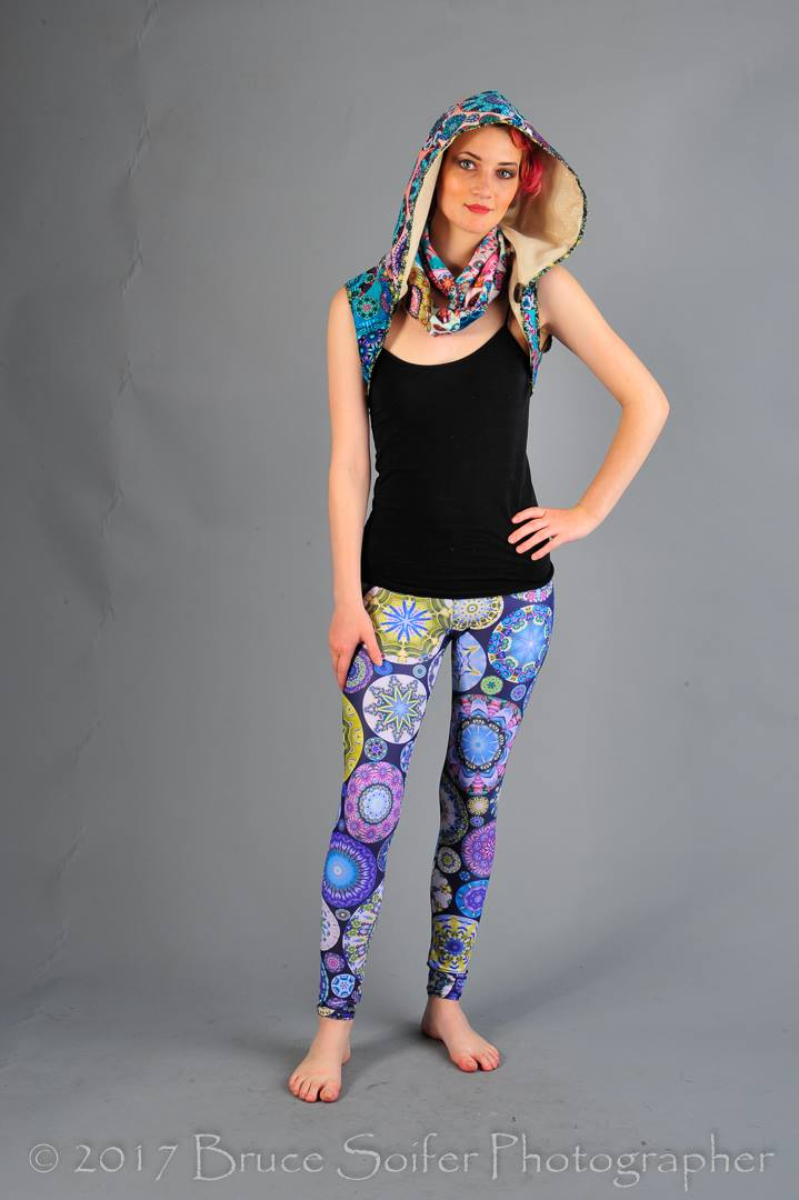 Lilith is wearing my hooded caplet created from several  Fancy Floral Kaleidoscope  designs in Minky combined with my thrift store gold fabric. She is also sporting a matching infinity scarf and  Flower Face Leggings  in Vivid Violet!