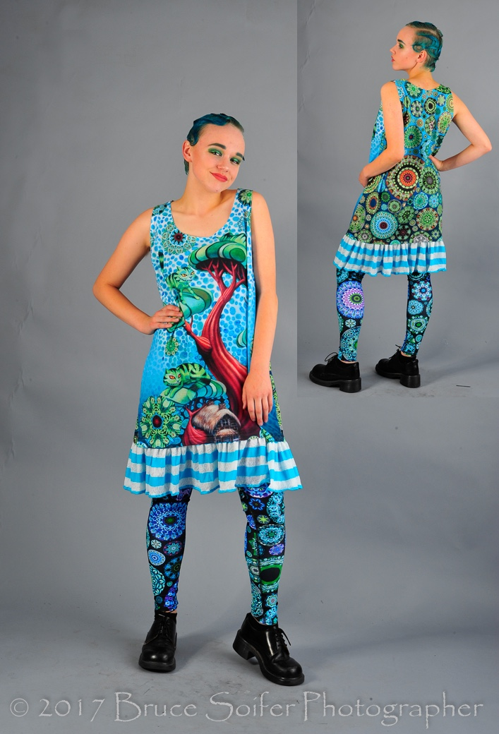 Ashley is modeling my Cheshire Tank Dress. There are two of these available for purchase, so  contact me  if you would like one! The tank portion of the dress is dye sublimation printed of my Cheshire Tree painting and then I added the striped trim. The back is a gradient of kaleidoscopes.