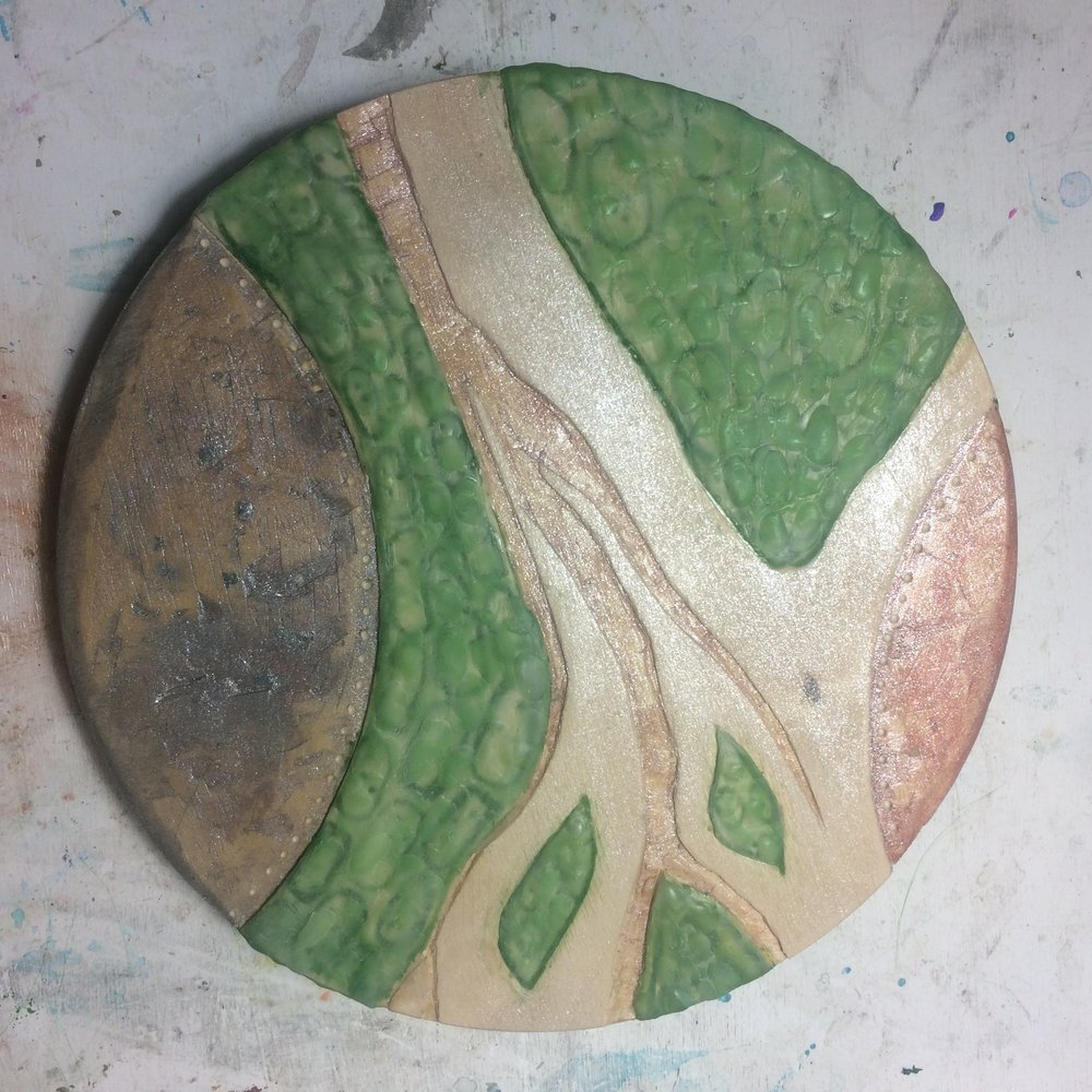 (K) Layers of textured green wax, woodburning tool.