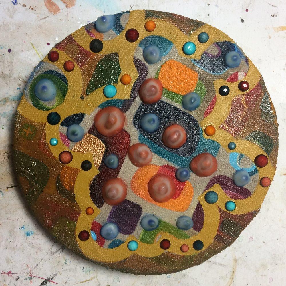 (A) Yellow Oxide design, rhinestones.
