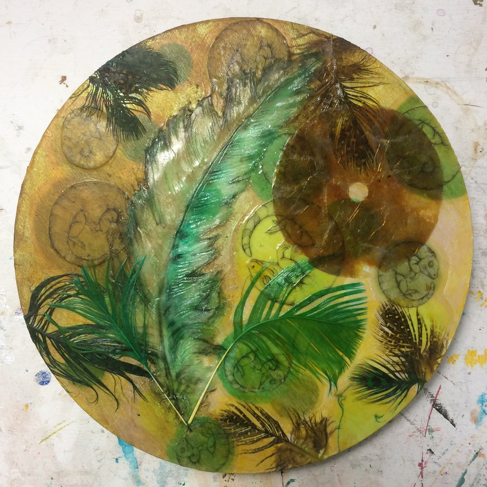(A) Acrylic, mica disc, more feathers.