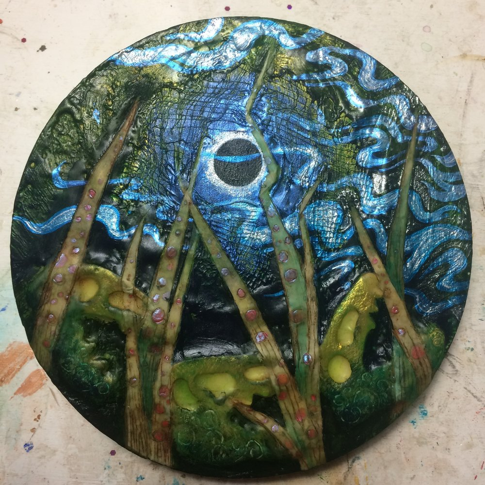 (A) Painted over dino eye, interference blue clouds, glaze of acrylic. (K) Wax around edge, pastels highlights, shimmer.