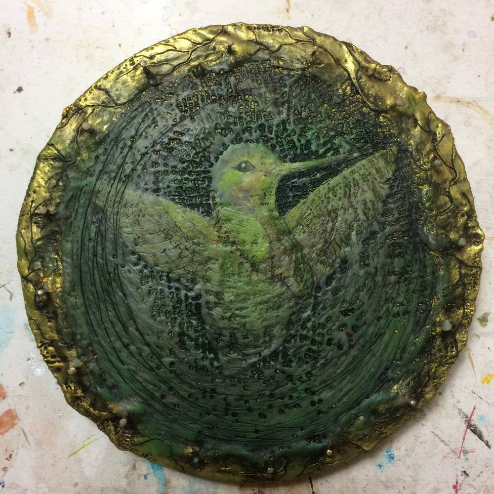 (K) Wax around center, texture, black pigment, green pan pastel.