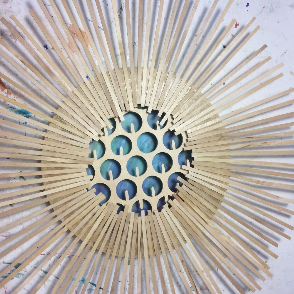 (K) Start. Encaustic, oil stick with wood cut-out floating. (A) Wood coffee stirrers.