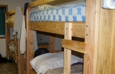 Old Wood Frame Bunk Beds that need to be replaced with metal frame bunk beds.