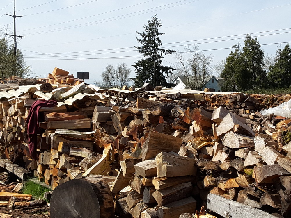 Piles of Firewood for sale by Albany Helping Hands.