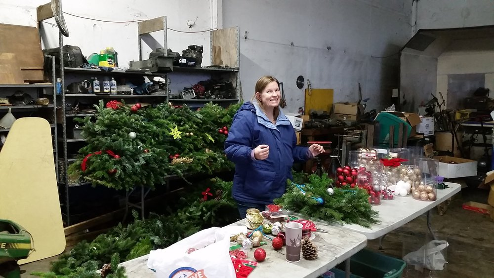 Christmas Wreaths being constructed by Volunteers at Albany Mennonite Church.