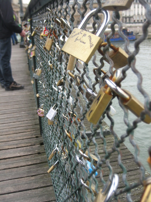This is a bridge in Paris. You hang locks on it with the name of you & your boyfriend/girlfriend/best-friend then throw the key into the river. So even though the friend/relationship may end, you can't remove the lock. It stays there forever, as relevance to someone once a part of your life.
