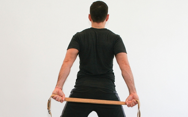 Outer arm bones roll back to open the chest, inner shoulder blades down the back.