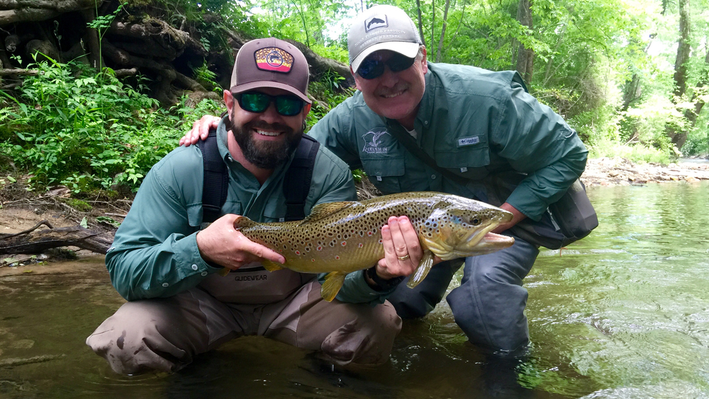 brown-trout-with-guide.jpg