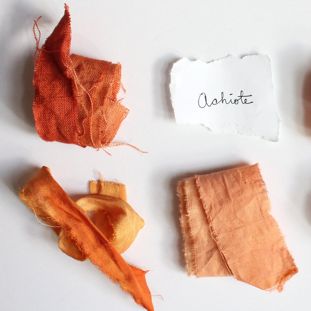 Achiote   Also called Annnato when used as a food coloring and known as Urucum in Brazil. It is the bright red seed of the plant which yields an orange or peach textile dye.