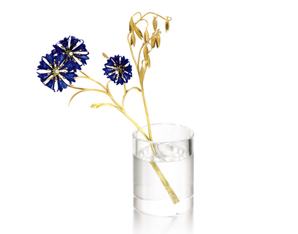 Faberge blue enamel and yellow gold cornflower in a rock crystal vase.