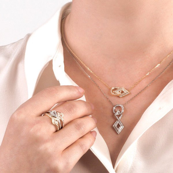 Layered pendants and rings in white and yellow gold and pave set with diamonds from Gararrard's new 24 Collection.