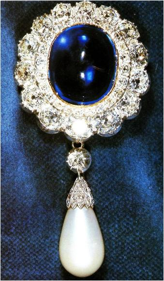 The pearl, sapphire and diamond brooch Queen Mary bought from the Empress Marie Feodorovna's estate in 1929.  It had been given to the Empress as a wedding present from her sister, the future Queen Alexandra.