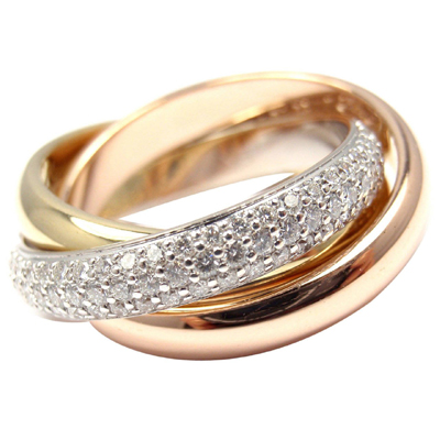 Trinity ring by Cartier.  Pave setting the white gold band with diamonds makes the most of enhancing the three colours of gold.