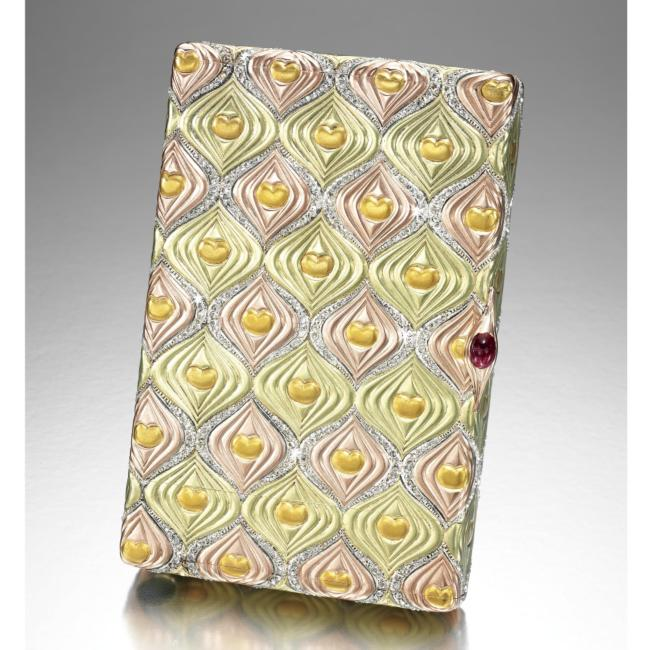 A distinctive four colour gold cigarette case by Faberge in the Art Nouveau style.