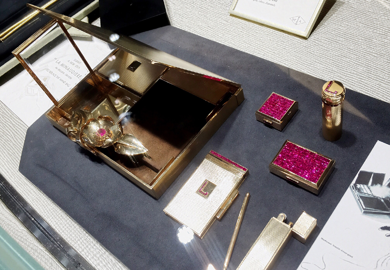 The minaudiere: a must have for any 1920s flapper, this extravagant alternative to a handbag contains a lipstick holder, compact, pencil, pill box, lighter and cigarette case.  The surfaces have been embellished with invisibly set rubies.