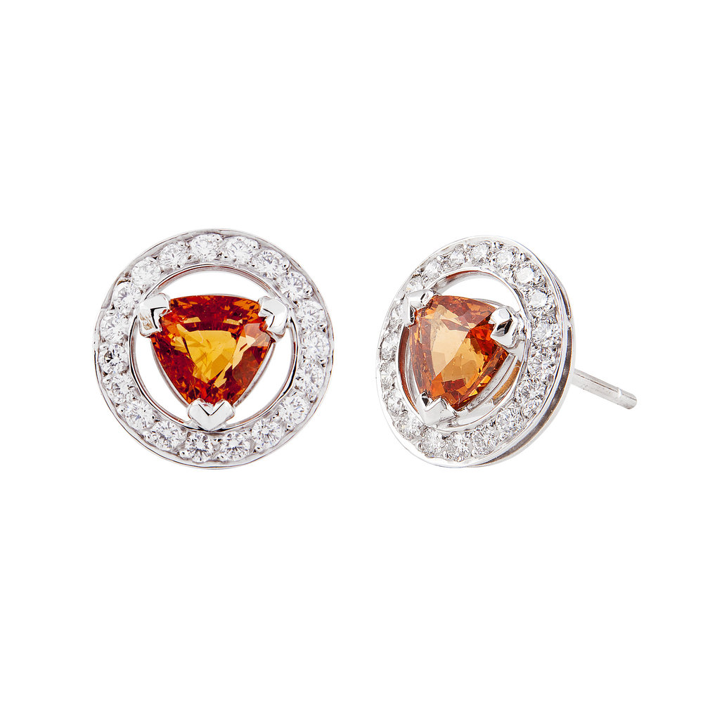 Mandarin garnet studs in a simple but striking halo setting, made to order.