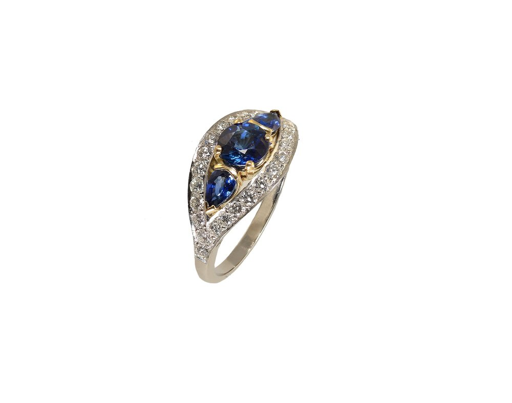 A sapphire and diamond engagement ring made specially to order.