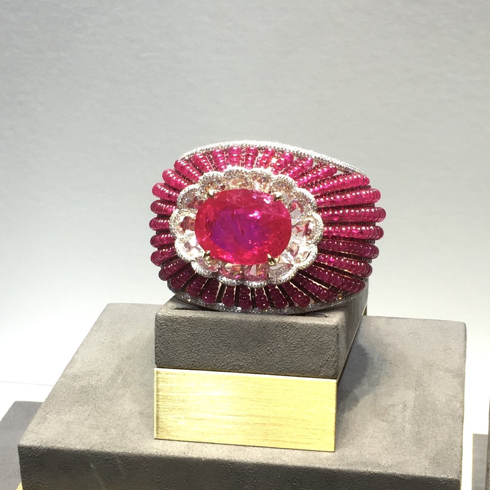 A magnificent ruby and diamond cuff by Chatila, featuring a Burmese ruby of over 65 carats.