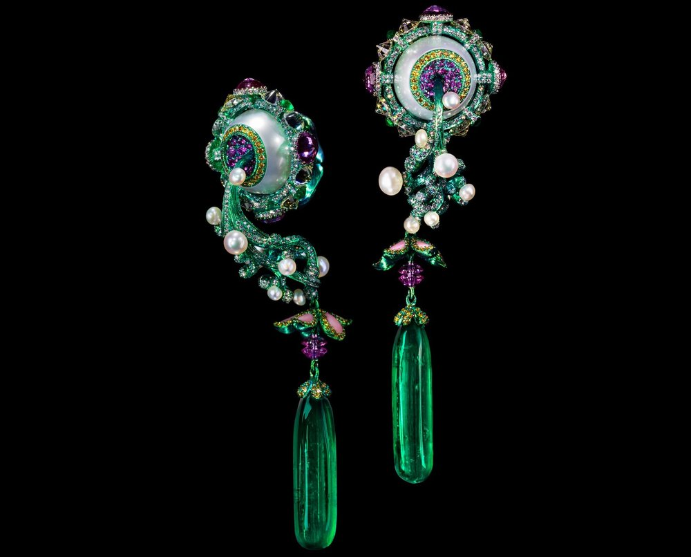 A pair of emerald, coloured diamond and conch pearl earrings by Wallace Chan.