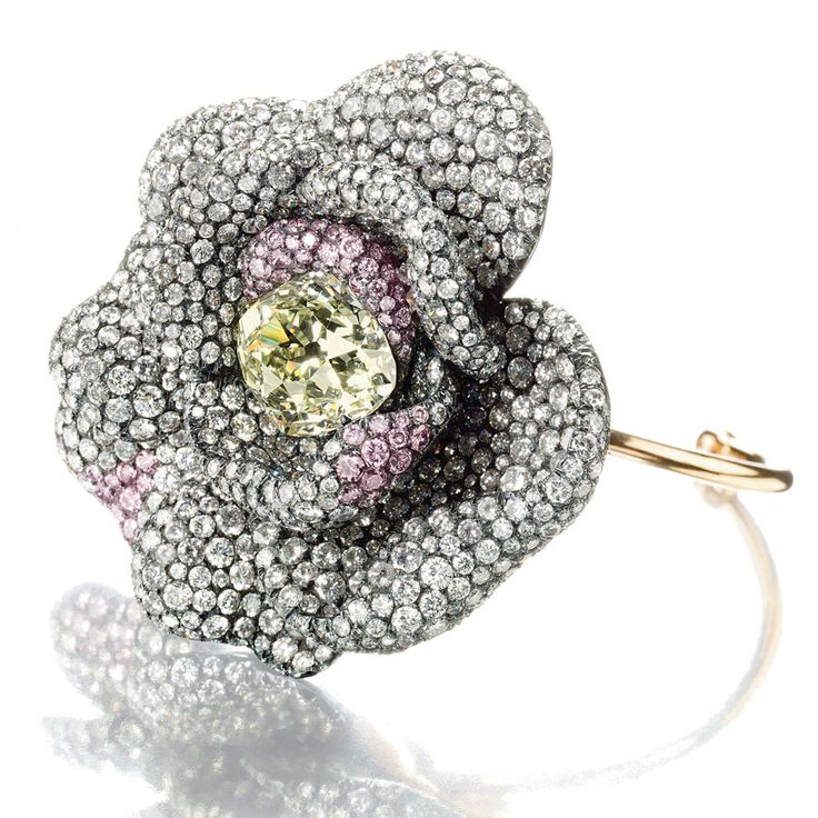 Pave set flower ring by JAR.  To test the smoothness of the pave setting he runs a silk scarf over the surface to make sure it doesn't snag.