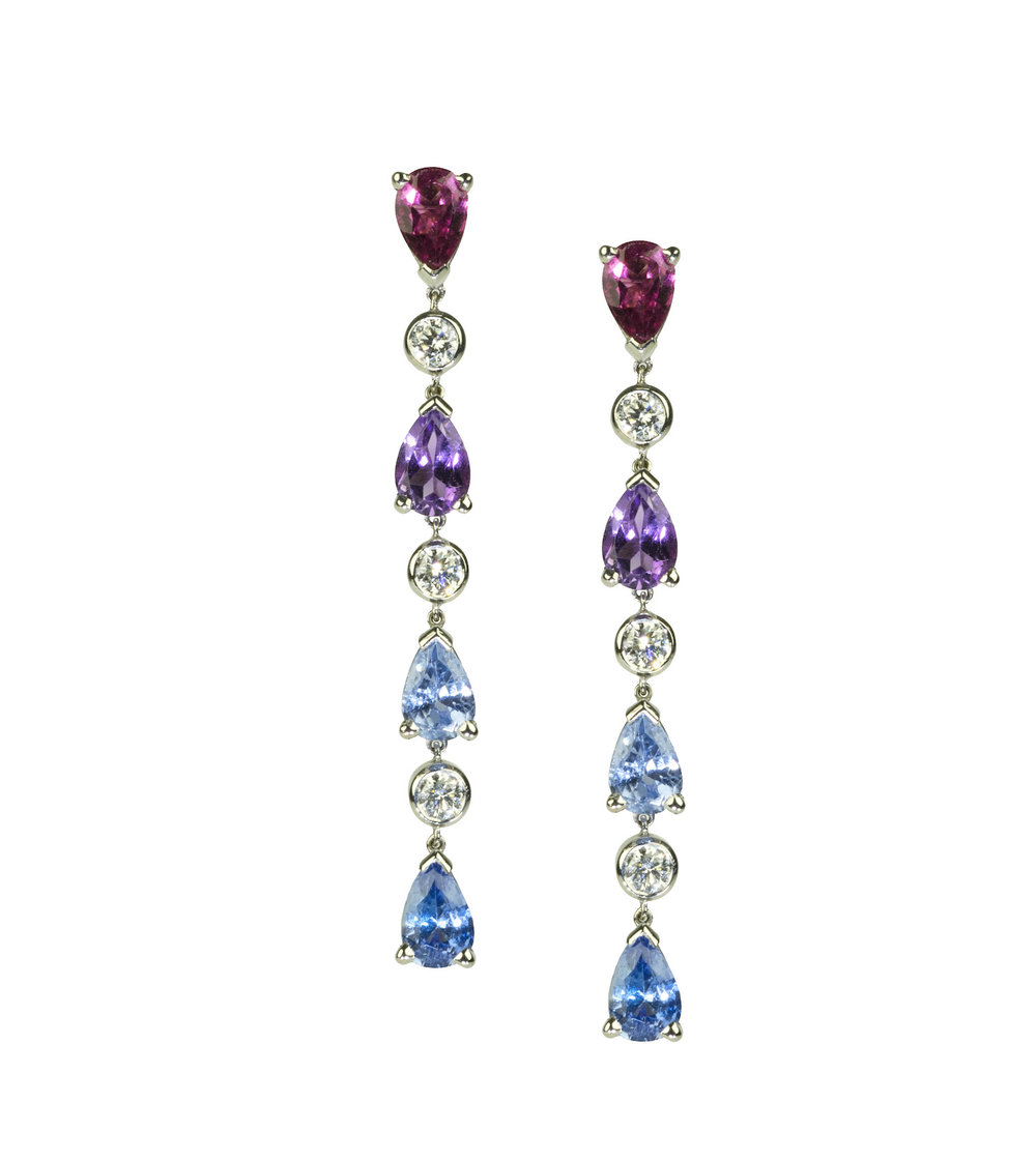 A pair of multi colour sapphire and diamond drop earrings commissioned to celebrate a milestone anniversary.